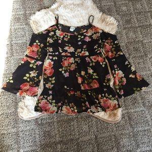 Sheer floral cold shoulder shirt.